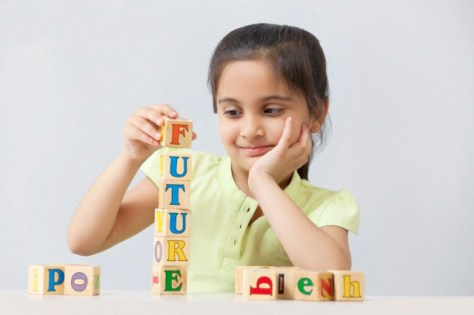 Girl playing with building block toys