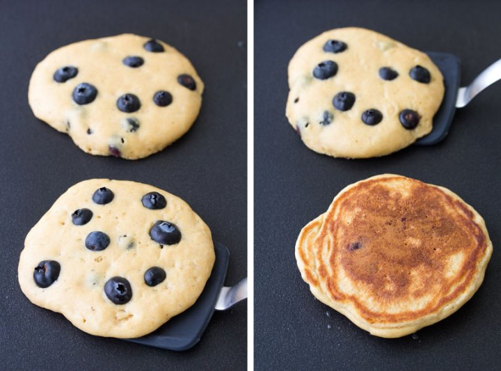 Cooking blueberry pancakes on a griddle, and flipping the pancakes.
