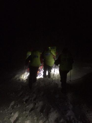 Last Team members and kit making their way off the hill