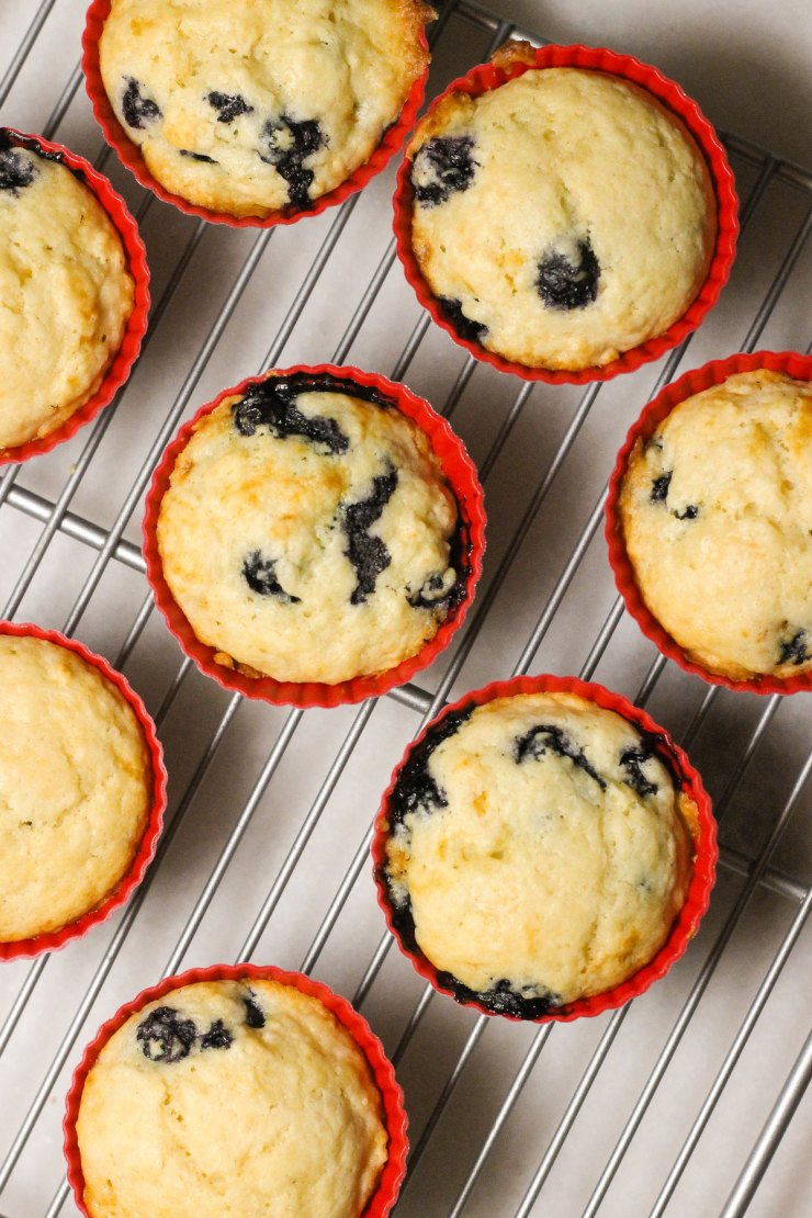 Buttermilk blueberry muffins on a cooling rack