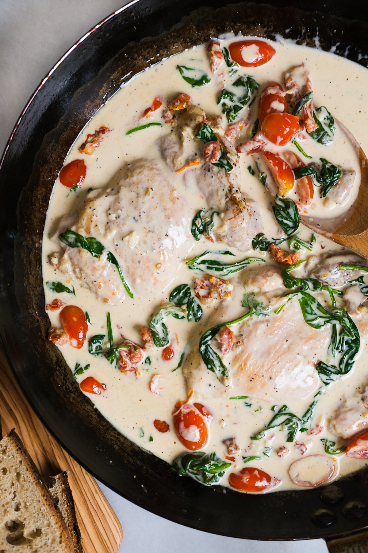 creamy tuscan chicken thighs in a pan