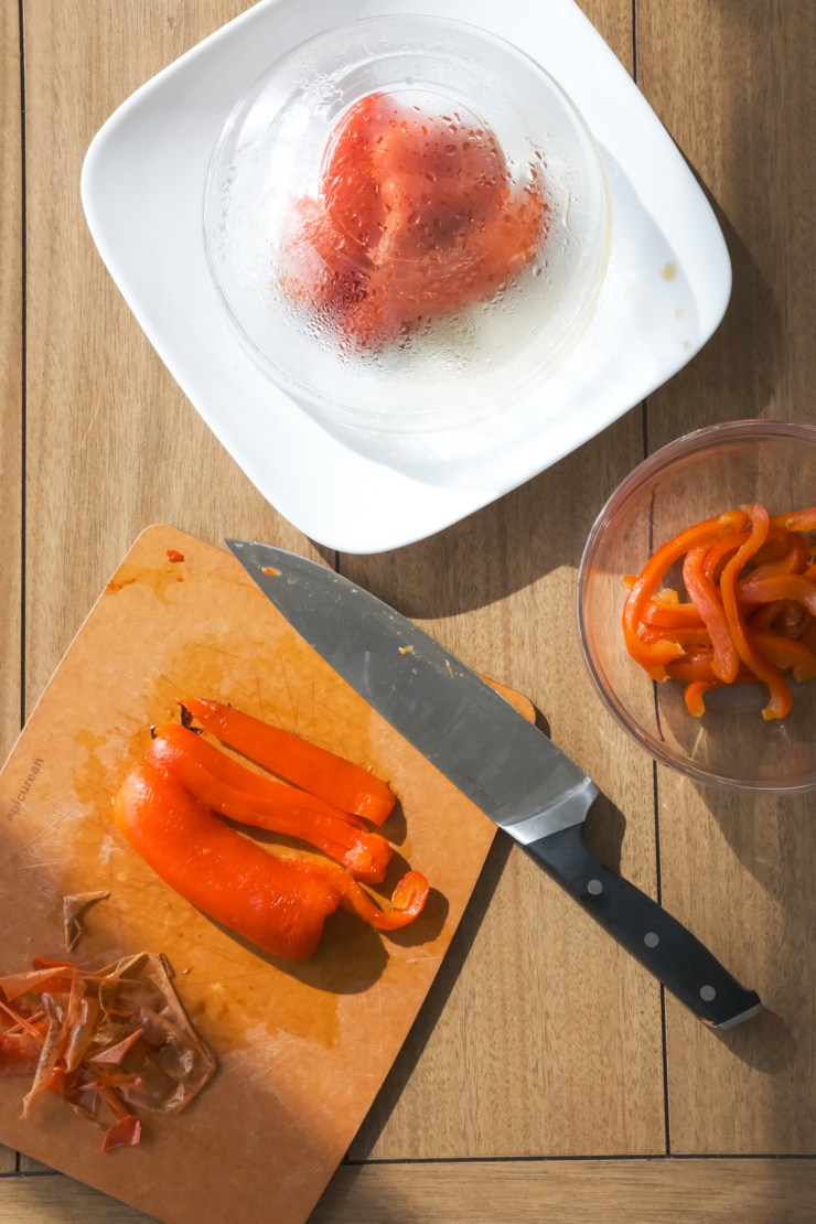 cutting up roasted red peppers