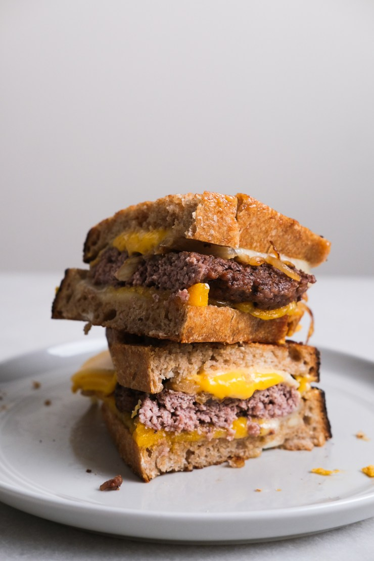 patty melt halves stacked on top of each other