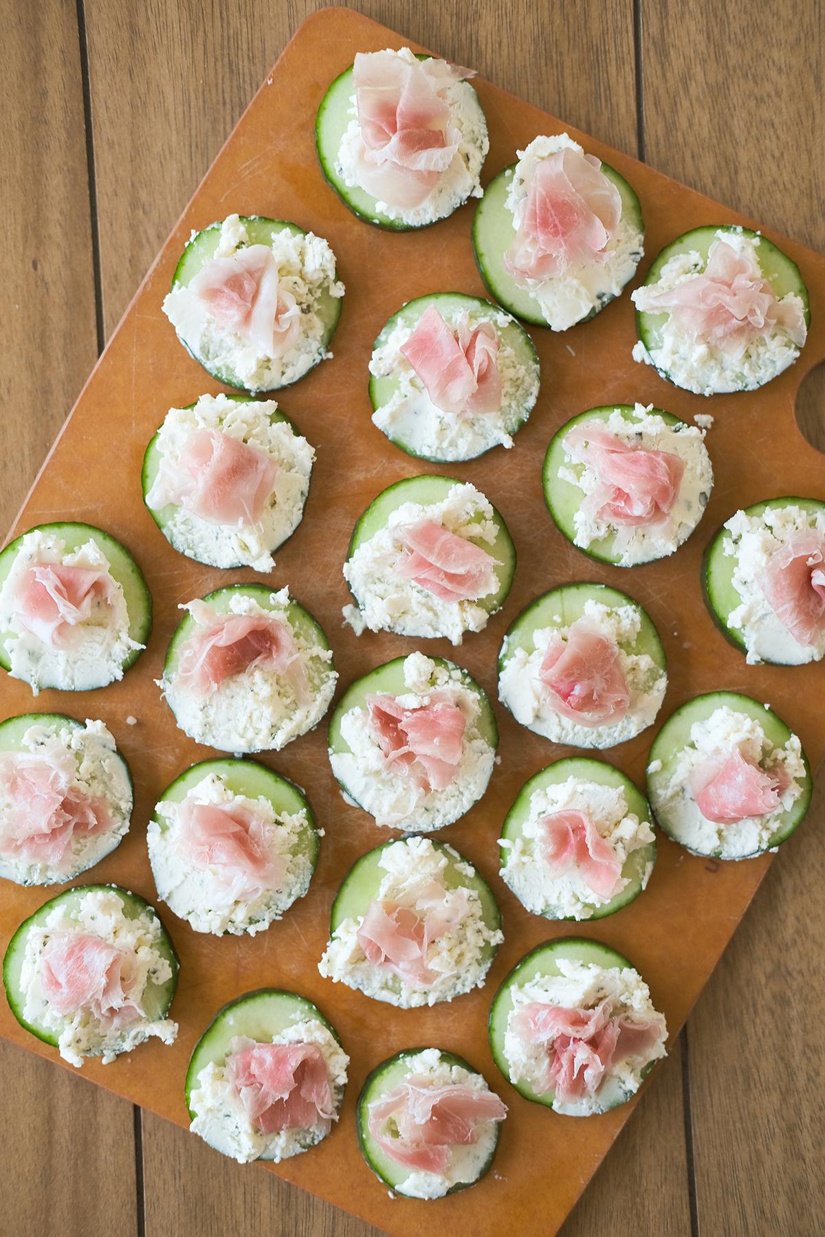 assembling prosciutto cucumber bites appetizer