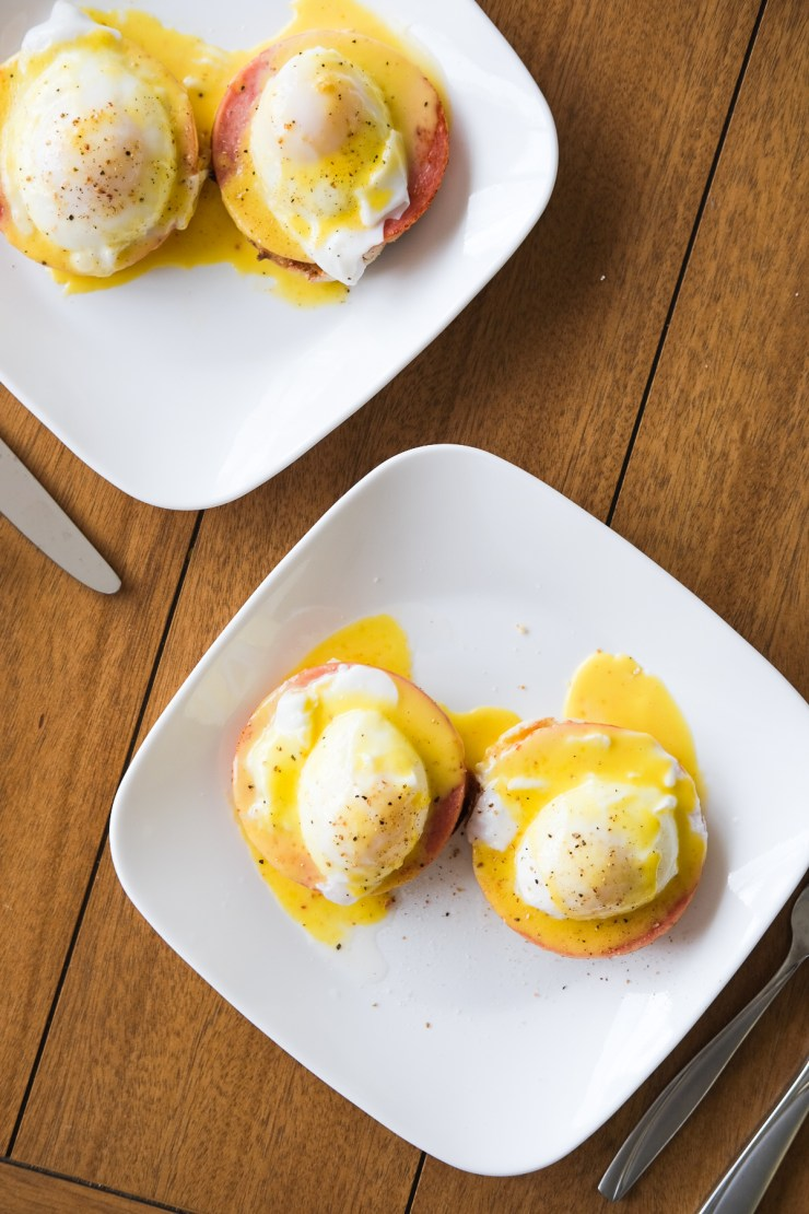 plates of eggs benedict with hollandaise sauce