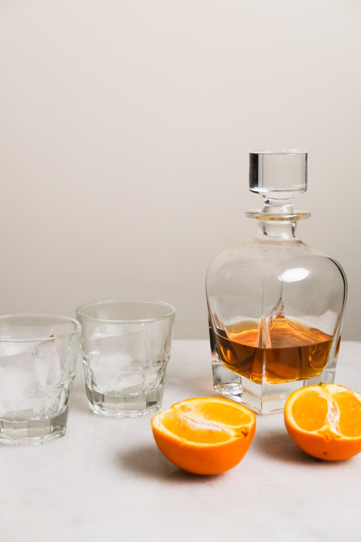 setting up to make an orange whiskey sours