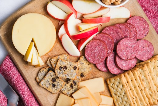 cheese board with meat and apples