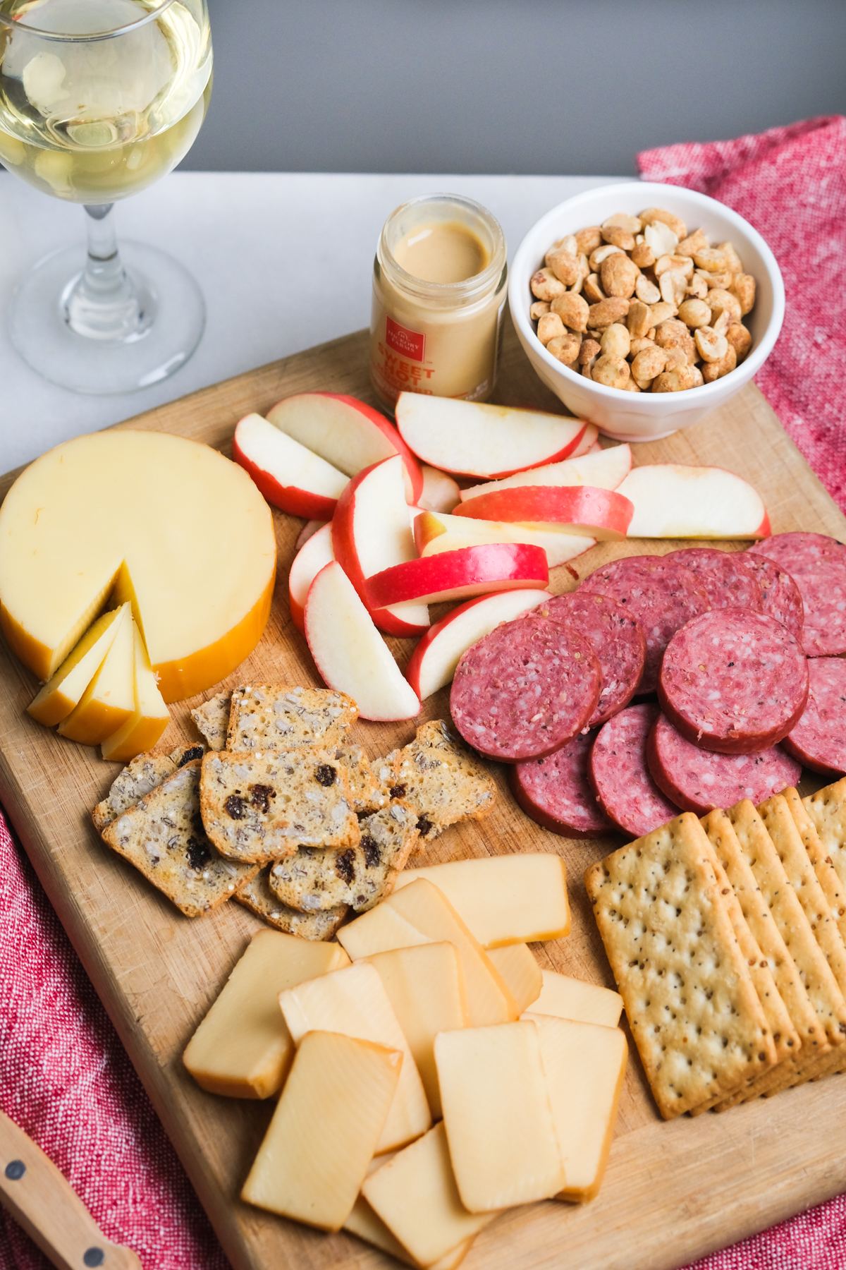 easy cheese board with glass of white wine