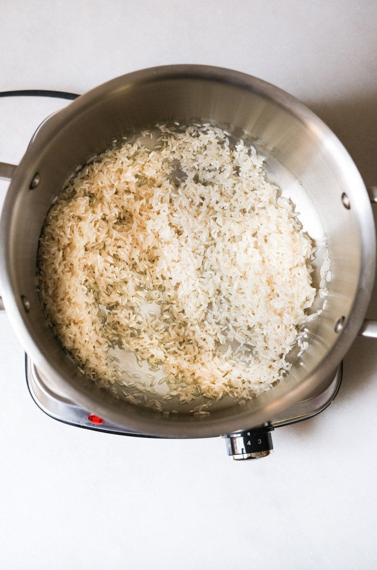 precooking rice with oil in a pot for Mexican rice