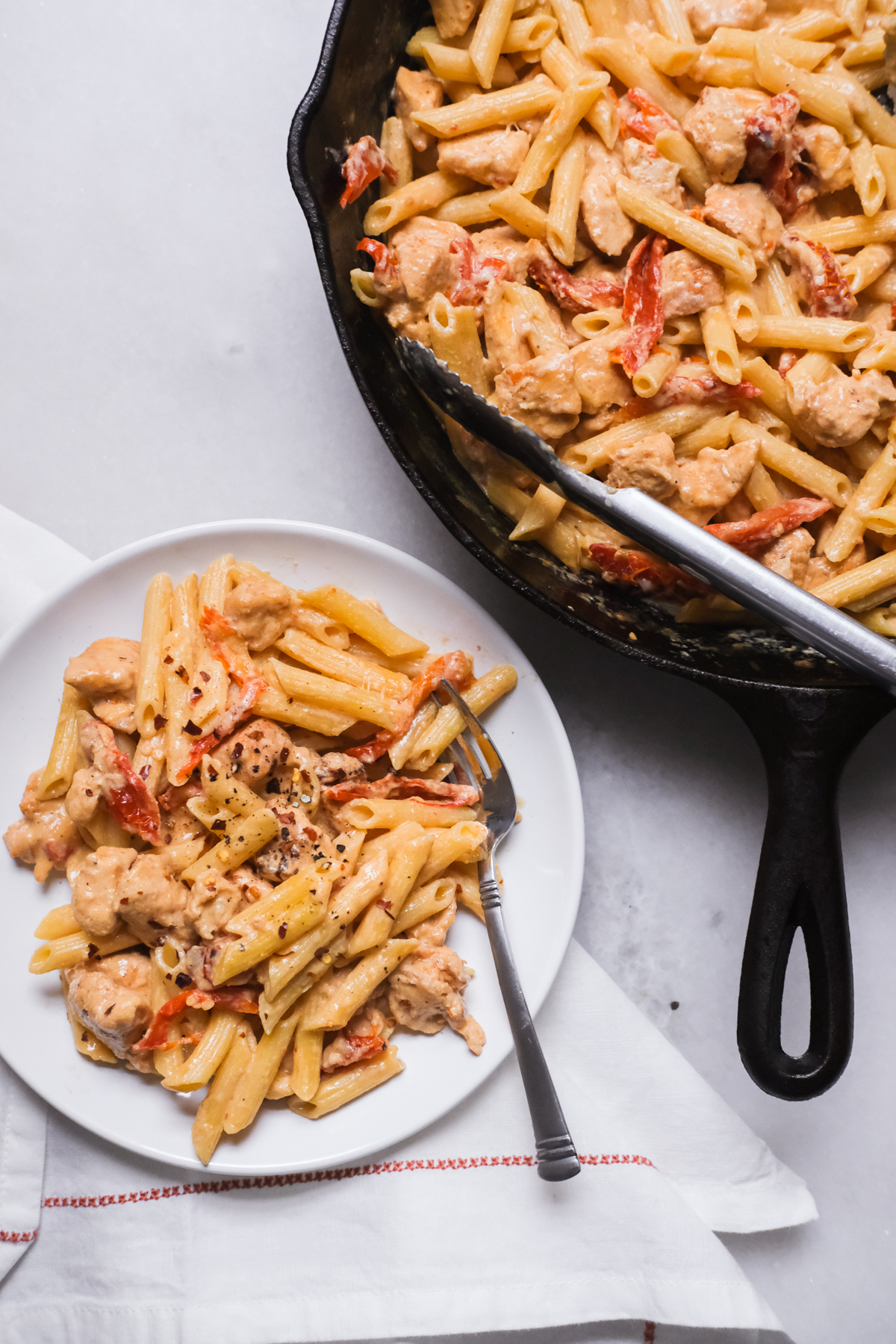 creamy chicken pasta in a cast iron skillet