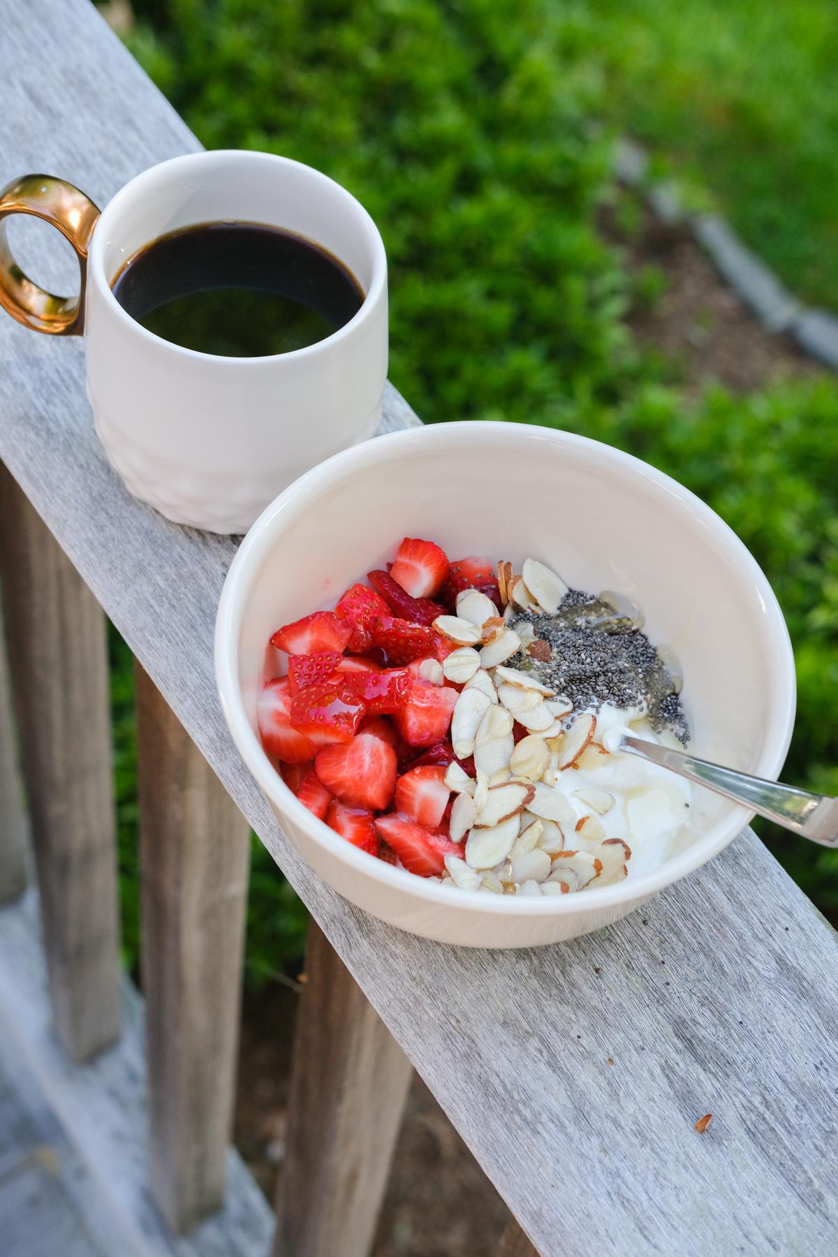 greek yogurt bowl with coffee on the porch