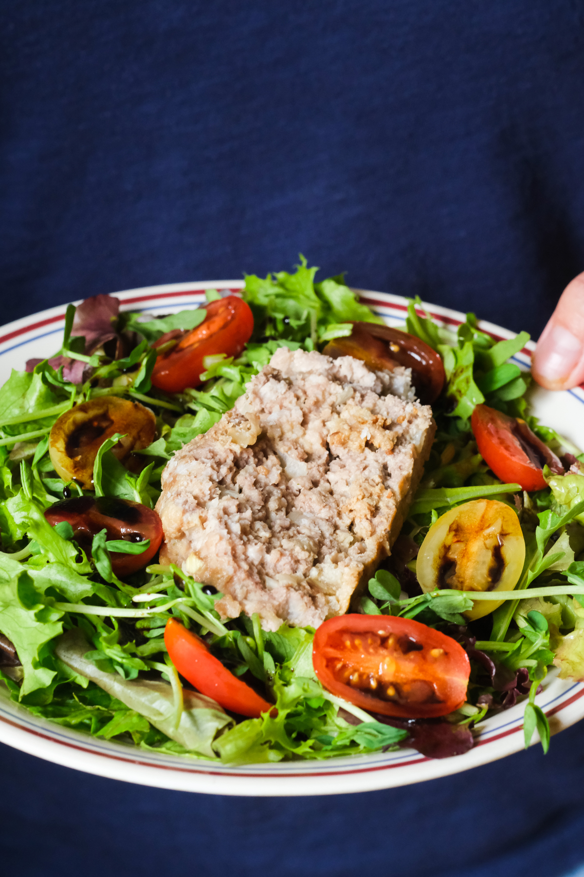 meatloaf salad with greens tomatoes and balsamic