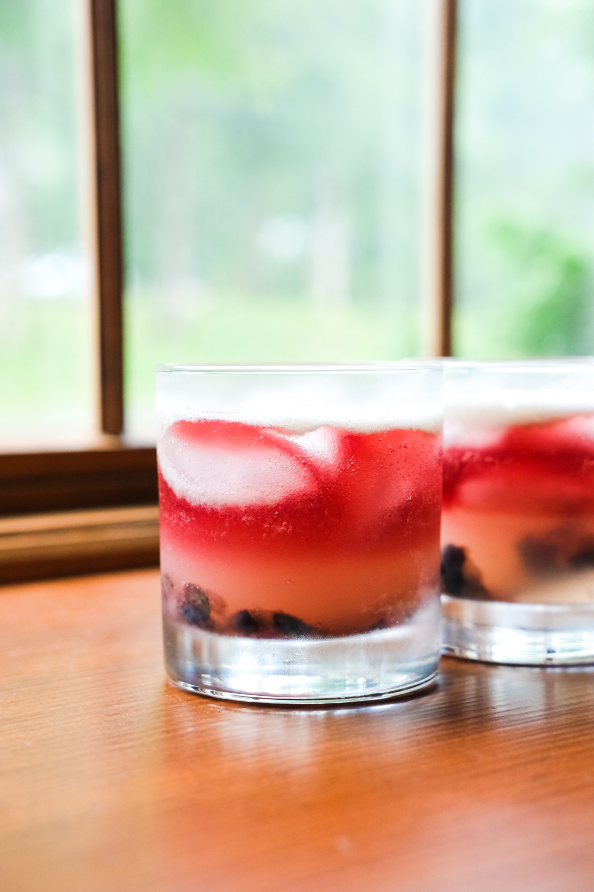 old glory cocktails on a window