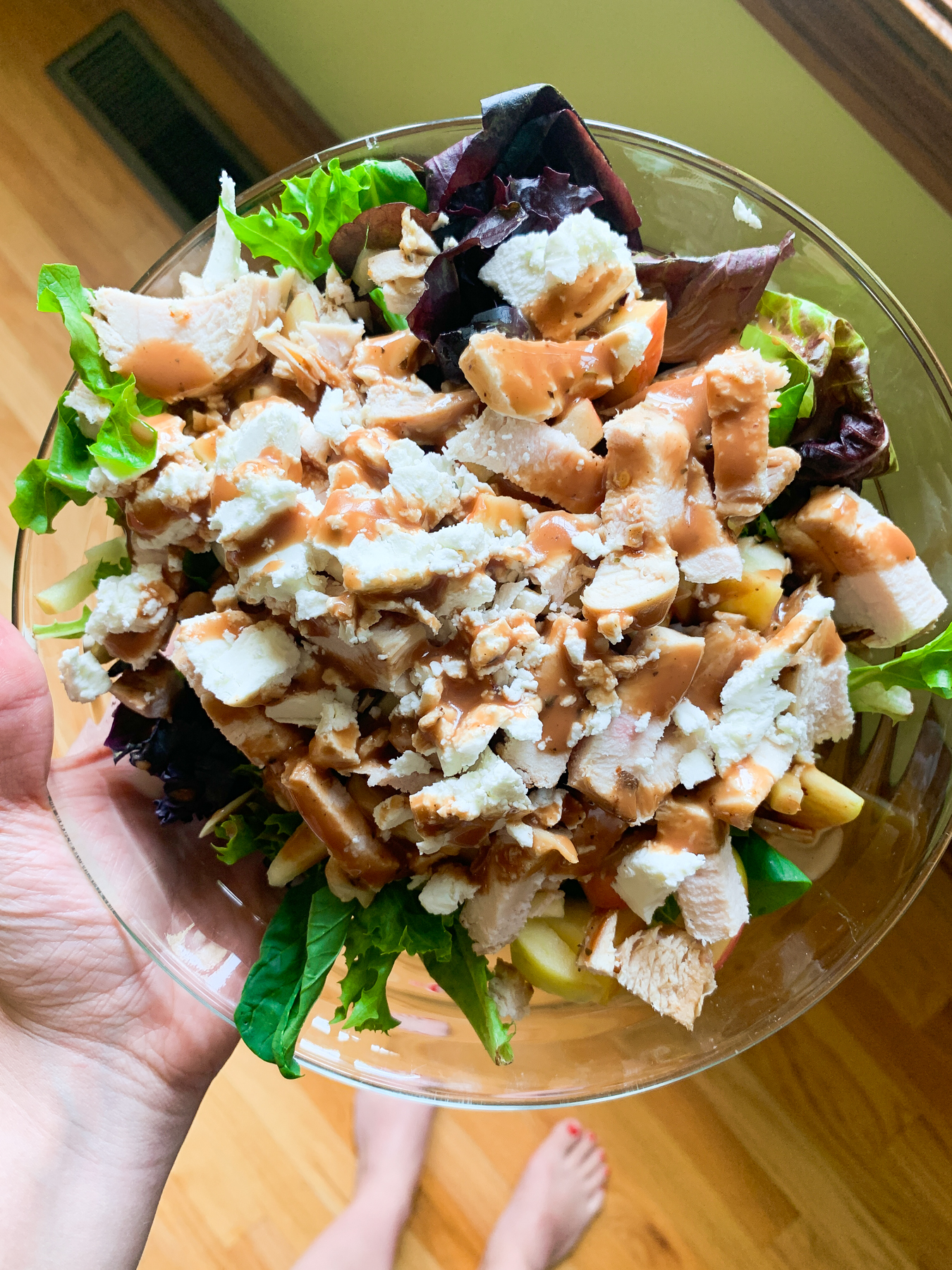 mixed green salad with apples, goat cheese, almonds, chicken, and balsamic