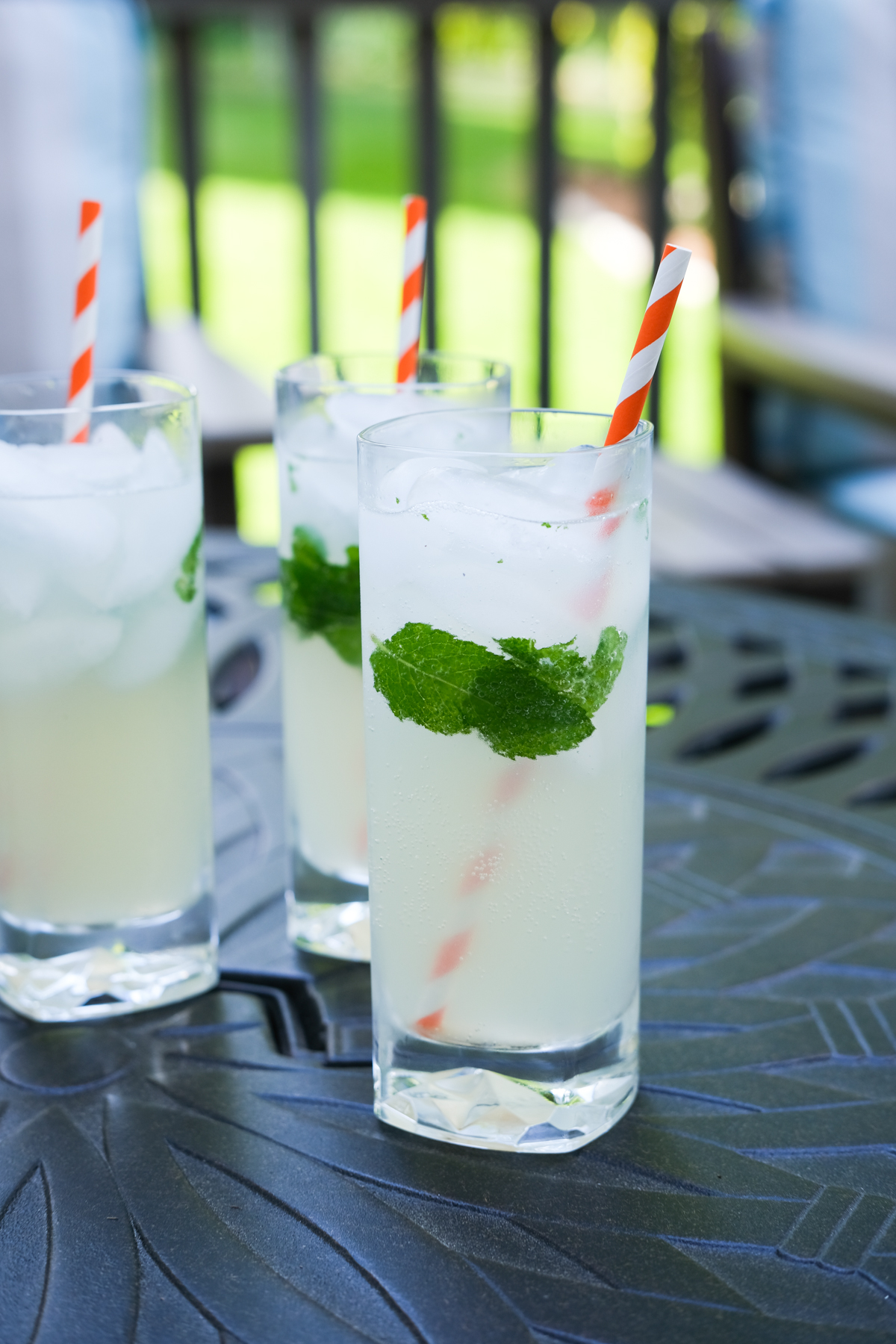 three mojitos on a table outside