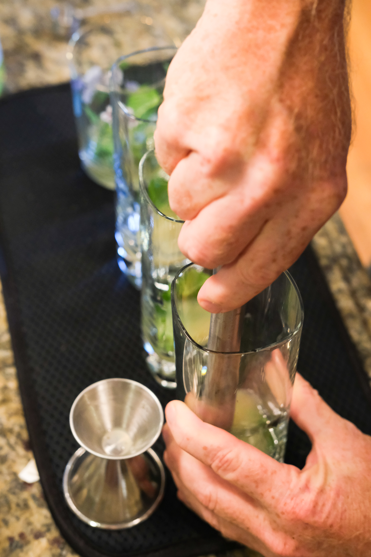 muddling the mint for mojitos