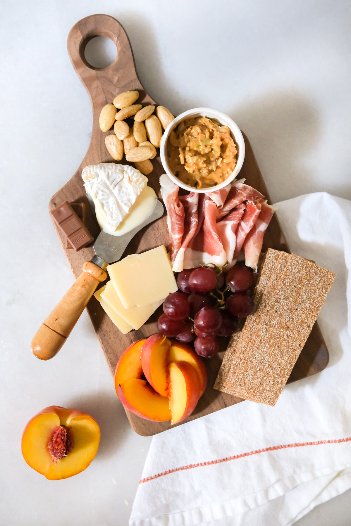 mini charcuterie board for one with fruit and cheese