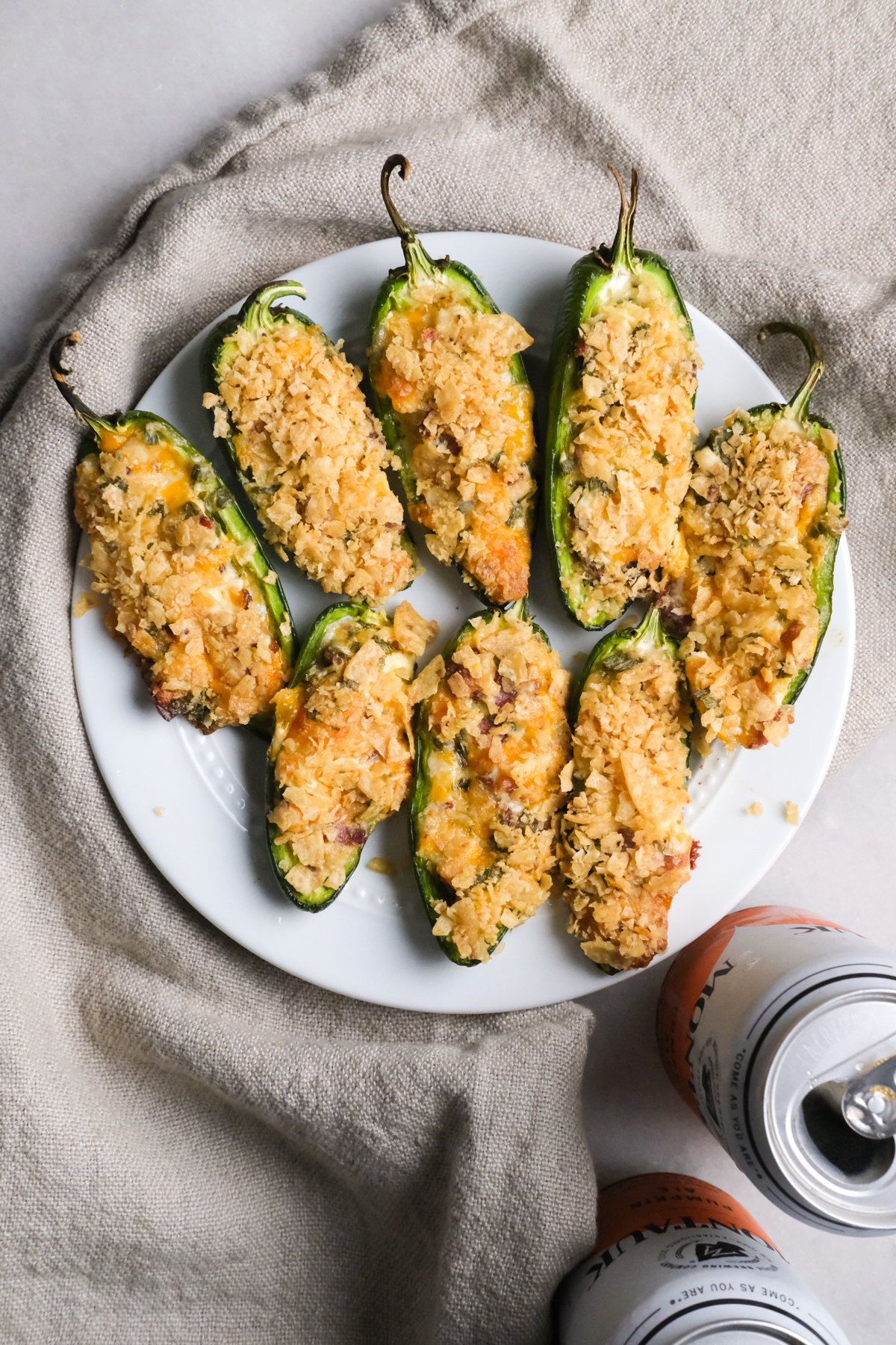 jalapeno poppers on a plate with crispy chip topping