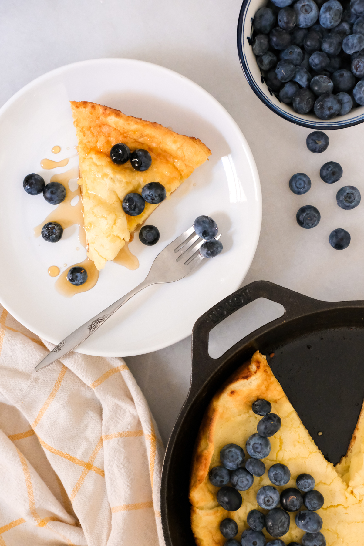 slice of buttermilk dutch baby with blueberries