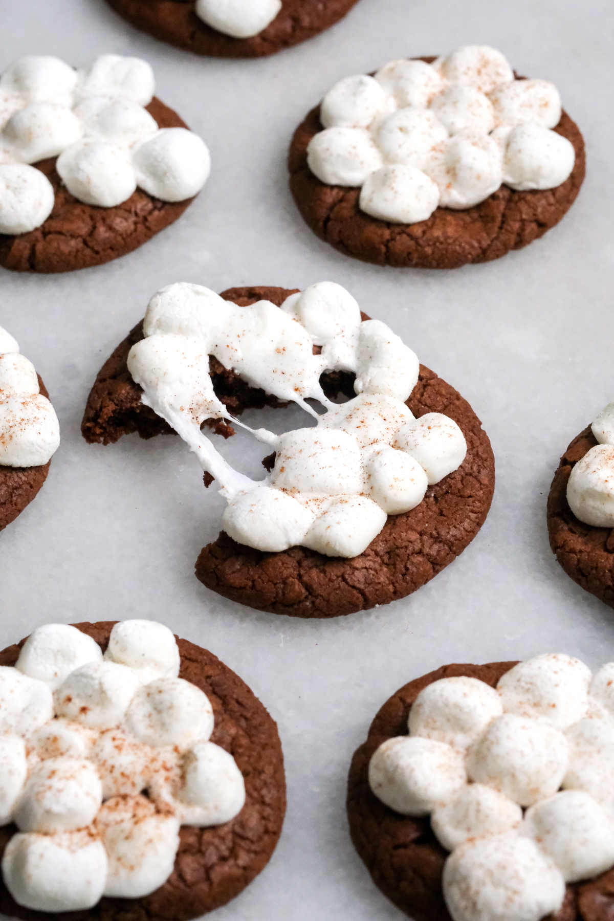 splitting a hot chocolate cookie with melted marshmallows on top