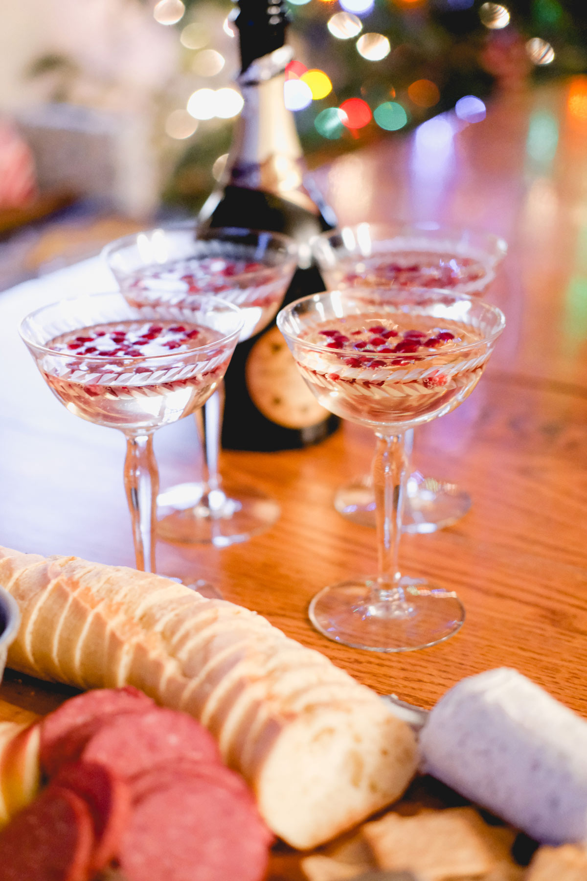 festive prosecco cocktail with charcuterie board