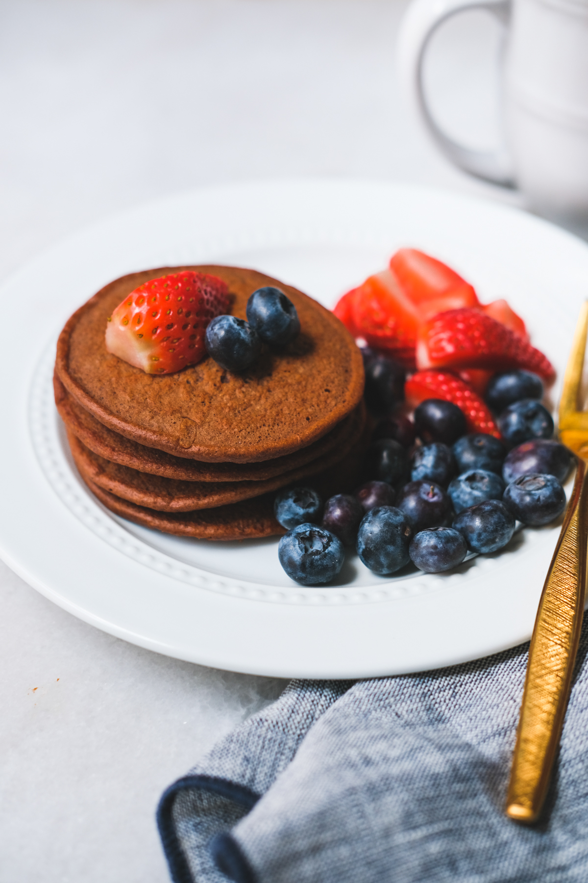 chocolate protein pancakes stacked on a plate