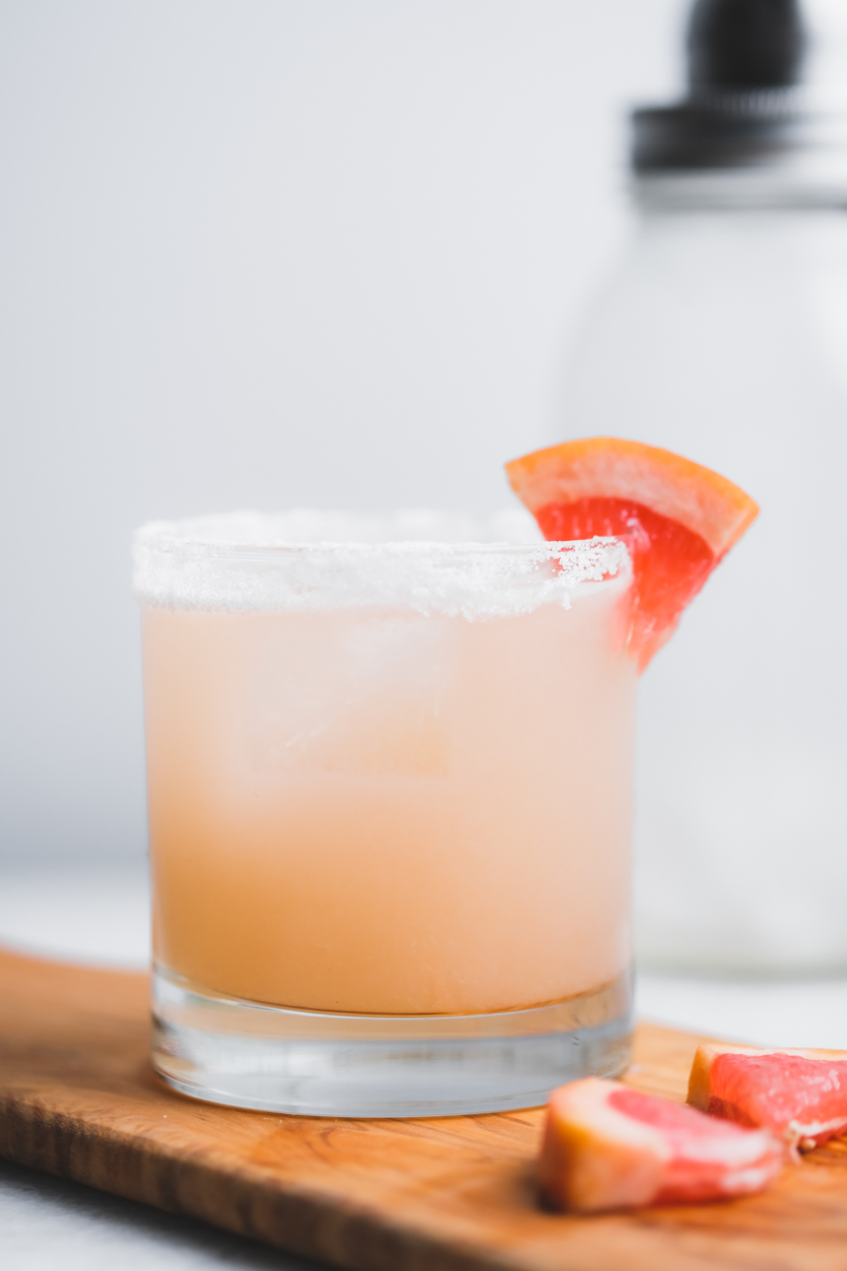 mezcal paloma cocktail with grapefruit wedges
