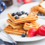 old fashioned waffles with berries on a breakfast table
