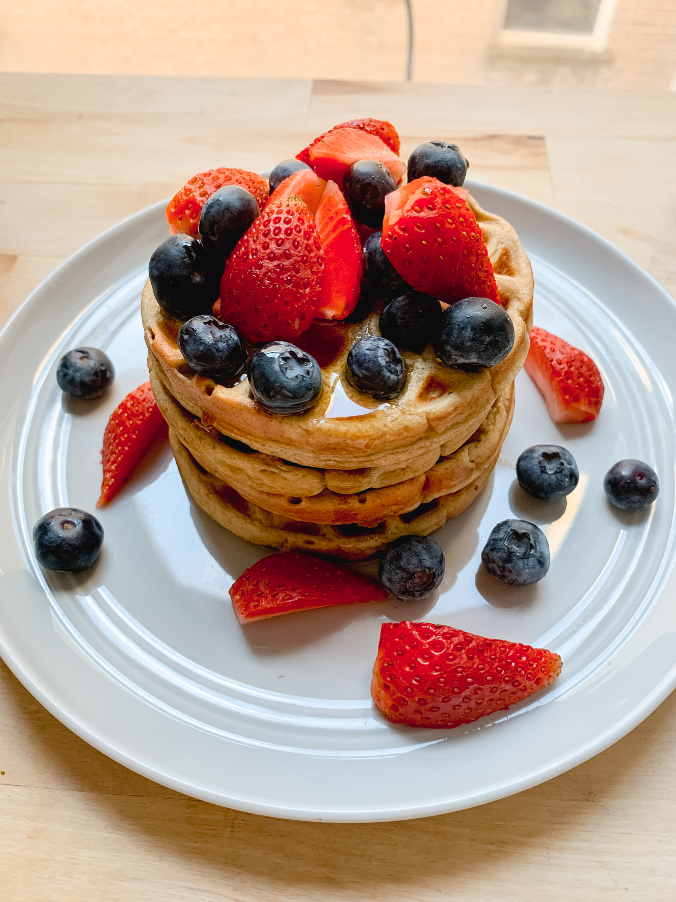 protein waffles with berries stacked on top of each other