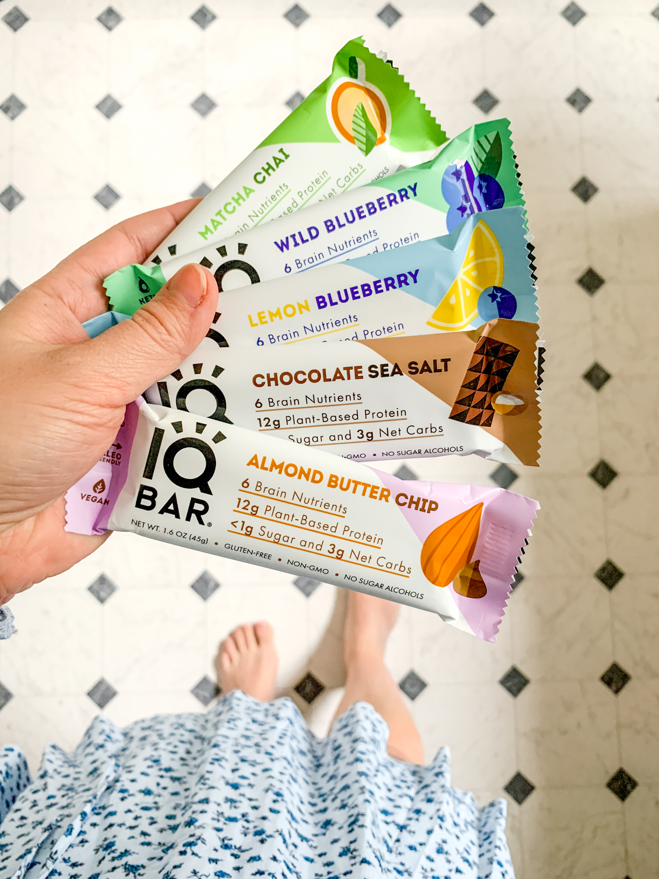 Holding different flavors of IQ bars