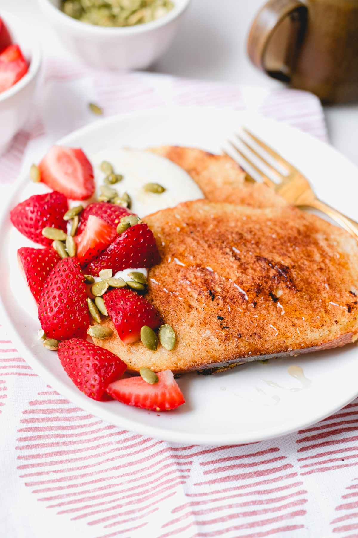 honey whipped ricotta french toast with strawberries and pepitas