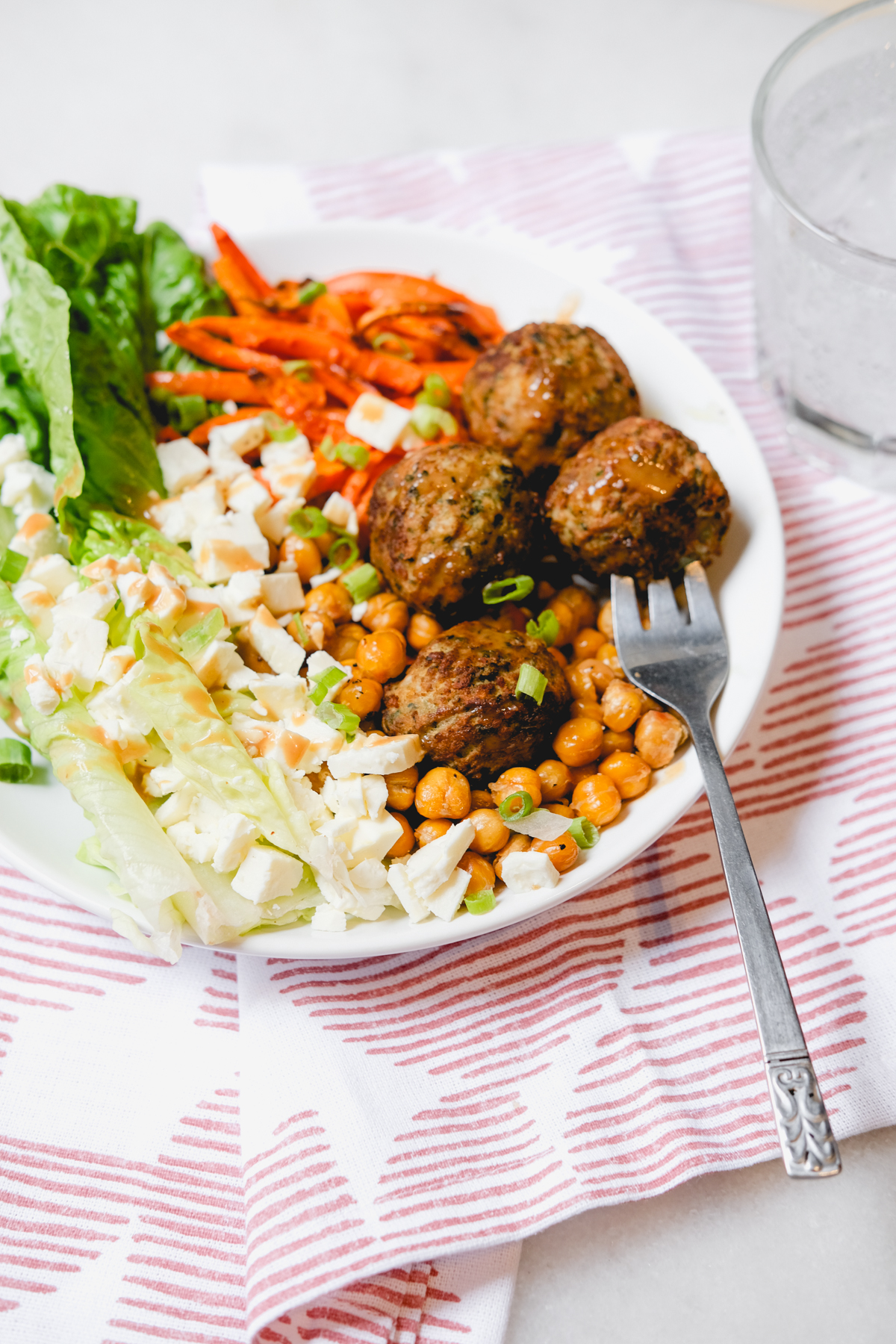 roasted meatballs chickpeas and carrots in a salad with romaine and feta