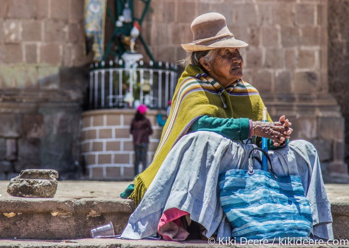Woman on Cathedral Steps, Puno, Peru