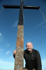 Family ties: Liebherr welder Anthony O'Shea, whose uncle, Tony O'Shea, built the original cross in 1976, was on hand to get the cross back up
