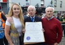 Declan Mangan, chairman, (centre) receives a presentation from the people of Massachusetts from Denis and Amanda Murphy
