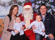 Twins Ollie and Dara with parents Clodagh and Gary Flynn and Santa