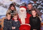 Ho ho ho, it's Joe, Joe Joe: Marte and Joe Huggard with their children Aiden, Tara and Amalie Huggard at Santa's Cabin
