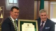 Mayor John Sheahan presents the civic honour to Mick O'Dwyer