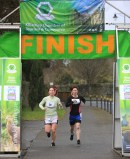 Aileen Murphy and Noreen Murphy reaching the finishing line