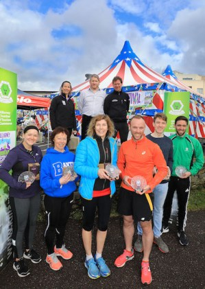 Winners of the 10K Park Run were, from left, Gabriella Flores (3rd), Geraldine O'Sullivan (2nd) Miriam Beazley (1st), Padraig O'Sullivan (1st) Darragh Casey, 2nd) and Tim Long (3rd) with, at back, Maureen Hegarty, Chairperson, Killarney Mountain Festival, Alan Ryan, Hardman Events, Piaras Kelly, KerryClimbing.ie