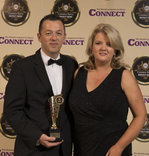 Paul O'Sullivan, Killarney Towers Hotel, receives the Best Hotel Pub award