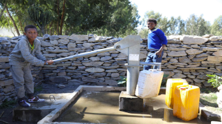Two young local boys show the benefits of the Trócaire supported water project