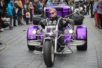 Purple Reign: The spectacular parade wheels its way through the streets