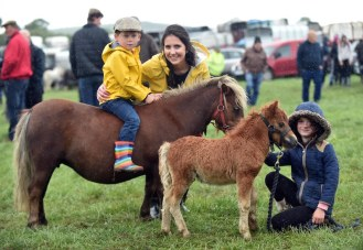 Catriona and Eoin O'Connor from Scartaglin and Aoibhinn O'Leary, Listowel, with ponies Jack and Jill