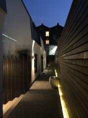 The communal entrance at dusk