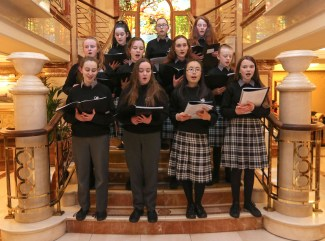 Choir members from Killarney Community College entertained guests