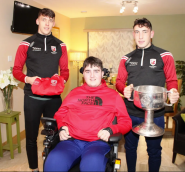 Star footballing brothers David (left) and Paudie Clifford with Ian at his home