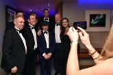 Guests pose for a selfie with Deputy Michael Healy-Rae