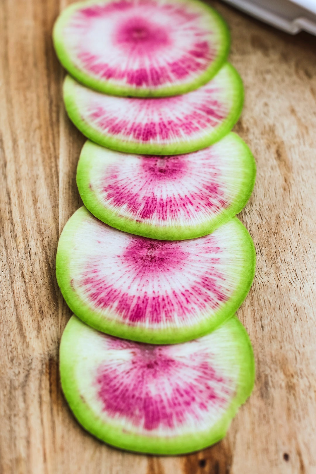 Watermelon Radishes With Anchovy Butter on Sliced Baguette | Killing Thyme