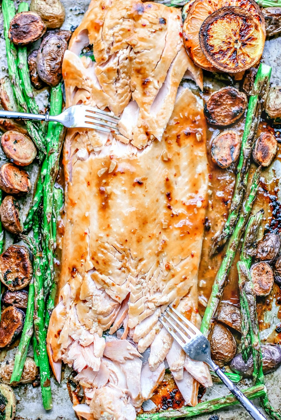 Easy Honey Citrus Sheet Pan Salmon with salmon flaked with a fork